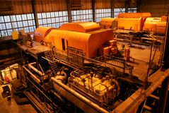 Steam turbine. And different size and shaped pipes at a power plant Royalty Free Stock Image