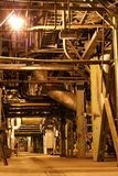 Steam turbine. Different size and shaped pipes at a power plant Stock Image