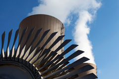Steam turbine against nuclear plant Stock Photos