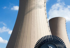 Steam turbine against a nuclear power plant Royalty Free Stock Photos