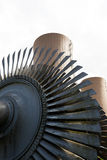 Steam turbine against a nuclear power plant Royalty Free Stock Images