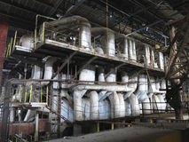 Steam turbine, machinery, pipes, tubes at power plant Stock Image
