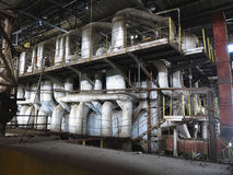 Steam turbine, machinery, pipes, tubes at power plant Royalty Free Stock Photos