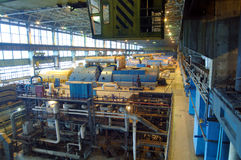 Steam turbine, machinery, tubes at a power plant Royalty Free Stock Photos