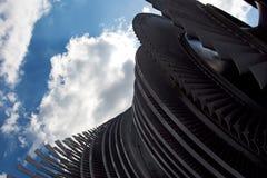 Steam turbine of nuclear power plant against the sky Stock Photos