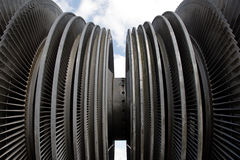 Steam turbine of nuclear power plant against sky and clouds Royalty Free Stock Images