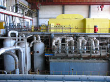 Steam turbine at a power plant. With tubes and machinery royalty free stock photography