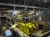 Steam turbine during repair, machinery, pipes, tubes at a power Stock Images