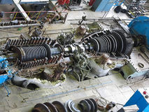 Steam turbine in repair process, machinery, pipes, tubes, at pow Stock Photo