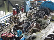 Steam turbine in repair process, machinery, pipes, tubes, at pow Royalty Free Stock Photos