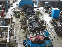 Steam turbine in repair process, machinery, pipes, tubes, at pow Royalty Free Stock Photography