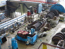 Steam turbine in repair process, machinery, pipes, tubes, at pow Stock Photos
