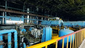 Power plant turbine room. Steam turbine and shaped pipes at power plant stock video
