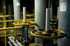 Steam valves. In closed power plant Stock Photos