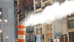 Steam venting from the street New York City Manahattan. Steam venting from the street in New York City Manahattan stock video footage