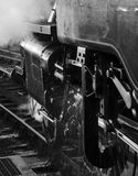 Steam and water. Detail of steam train and water splashes Stock Image