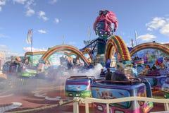 Steam in wheeling octopussy whirligig at Oktoberfest, Stuttgart. STUTTGART, GERMANY - OCTOBER 02: foreshortening of white steam in wheeling octopussy whirligig Royalty Free Stock Photos