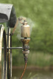 Steam whistle. Closeup of railway train whistle in brass with pipes, steam, and dials Stock Images