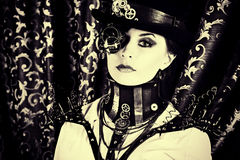 Steam woman. Portrait of a beautiful steampunk woman over vintage background Stock Photography
