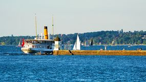 Steamboat on Geneva Lake at pier in summer Switzerland Stock Photos