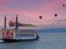 Steamboat and hot air balloons Stock Photo