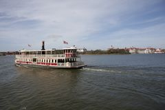 A steamboat leaving disneyworld. Orlando, Florida- February 7, 2018: A boat rides across the lake away from the Magic Kingdom at Disneyworld with Grand Floridian Royalty Free Stock Photos