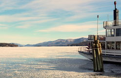 Steamboat moored for winter in snow and ice of lake Royalty Free Stock Photo