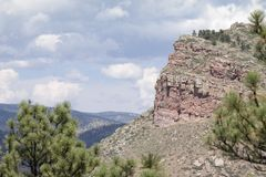 Steamboat Mountain. Landmark Steamboat Mountain located in Lyons, Colorado. The red sandstone mountain resembles a big river steamboat royalty free stock images