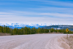 Steamboat Northern Rocky Mountains Alcan BC Canada. Snowy peaks of Northern Rockies landscape, Alaska Highway at Steamboat, British Columbia, Canada royalty free stock photo