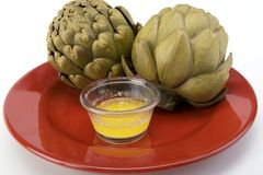Steamed Artichokes With Melted Butter Royalty Free Stock Photography