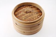 Bamboo Steamer with Cover. Isolated bamboo steamer with lid royalty free stock images