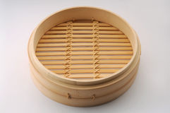 Bamboo Steamer. Isolated bamboo steamer on white background royalty free stock photo