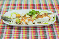 Steamed basa fish in lime dressing Stock Photo