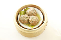 Steamed beef balls. Yumcha.   dim sum in bamboo steamer with chinese bun , pao , bao zi , steamed dumpling , shumai on table in chinese restaurant. chinese Stock Photography