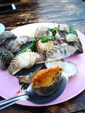 Steamed blanched clams with dipping sauce. Famous of Thailand seafood Street food Stock Photo