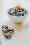 Steamed blanched clams in white bowl on wooden background Stock Images