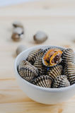 Steamed blanched clams in white bowl on wooden background Royalty Free Stock Photo