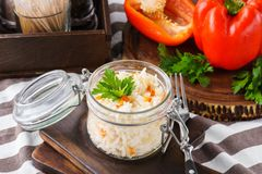Steamed or boiled rice with bell pepper and parsley in a jar stock image