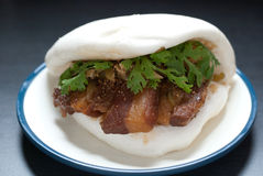 Steamed bread stuffed with pork stuffing. Coriander and peanut powder. Taiwan food.Also named Taiwan burger Stock Image