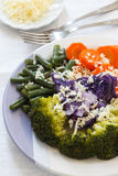 Steamed broccoli carrots, green beans, purple cabbage Stock Photos