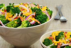 Broccoli salad with bacon, cheese and red onion. Steamed broccoli salad with bacon, cheese and red onion Royalty Free Stock Photography