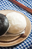 Steamed bun and sweet creamy stuff. Chinese steamed bun and sweet creamy stuff Stock Image