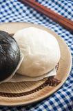 Steamed bun and sweet creamy stuff Stock Image