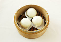 Steamed butter buns. Yumcha.   dim sum in bamboo steamer with chinese bun , pao , bao zi , steamed dumpling , shumai on table in chinese restaurant. chinese Stock Photo