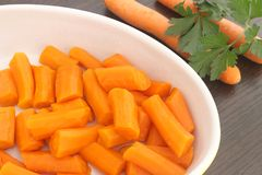 Steamed carrots Stock Images