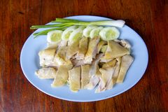 Steamed Chicken, located on the chopping board. Is to be cut to break away for some rice and sauce, steamed chicken and white rice royalty free stock photo