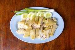 Steamed Chicken, located on the chopping board. Is to be cut to break away for some rice and sauce, steamed chicken and white rice stock image