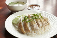 Steamed chicken with rice, soup, and spicy sauce Stock Photo