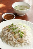 Steamed chicken with rice, soup, and spicy sauce Stock Image