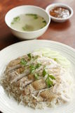 Steamed chicken with rice, soup, and spicy sauce Stock Images